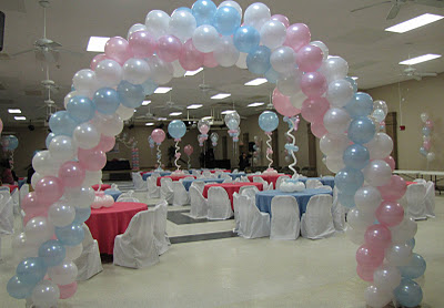 Balloon archways create a feeling of welcoming to a baby shower. The guests can't wait to walk under it!