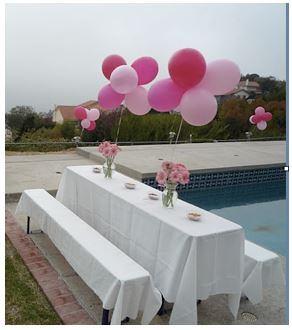 Try adding flowers to the base of a balloon cluster to really create an elegant centerpiece.